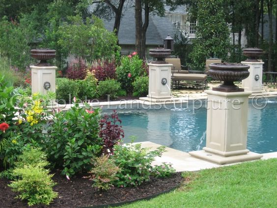 Formal Pool With Water Feature Columns Around The Edge Pool Water Features Pool Landscaping Water Features