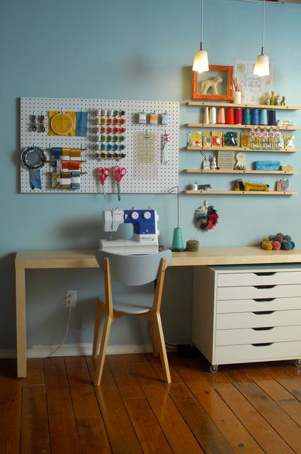Pegboard and shelves in a craftroom