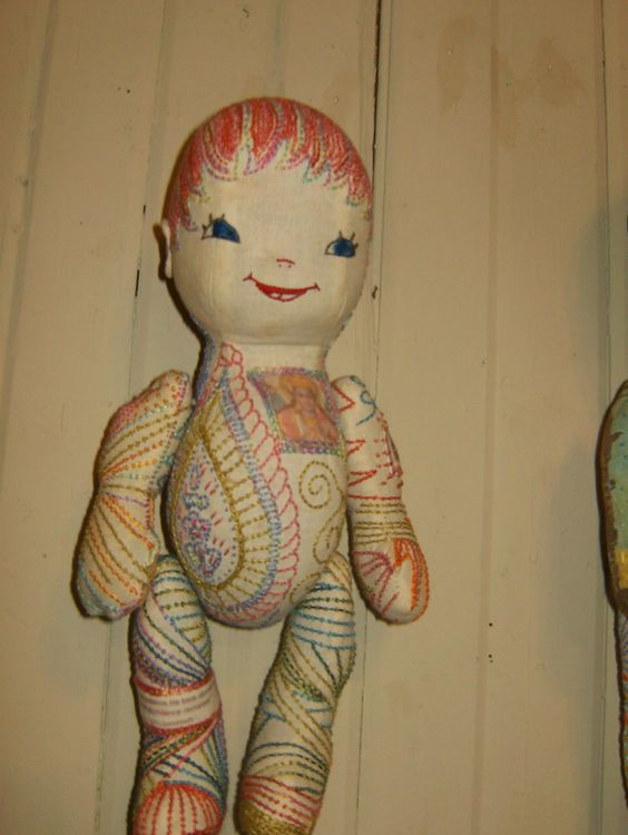 Identical Twin Pink.  Vintage cloth doll, mended and embellished with patches, computer printed images and embroidery.