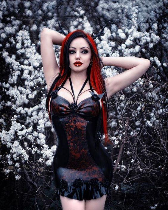Instagram media by anoukdyonnephotography - Model: @dani_divine  Photo/Retouch: @anoukdyonnephotography  Dress: @ausriefel  Antlers: @hysteriamachine  #fetish #fetishmodel #latex #latexmodel #danidivine #goth #altmodel #alternativemodel #pierced #blossom #anoukdyonnephotography