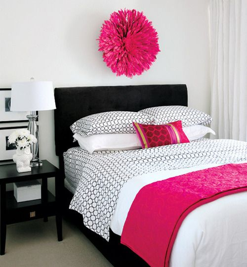 this neutral bedroom reads pink with just a pop of color using pops