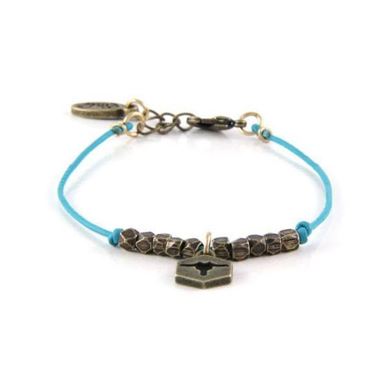 Charming the Wild West with Brass Bullhead Charm and Turquoise Leather Bracelet