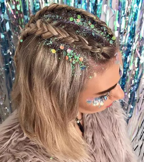 These glitter-encrusted Dutch braids are seriously to die for. I can't help but think how perfect this look would be for a holiday party!:
