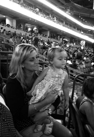 Her first time to the Forum and she saw the kids in front of her had popcorn... Daddy was at the concession stand 3 minutes later!
