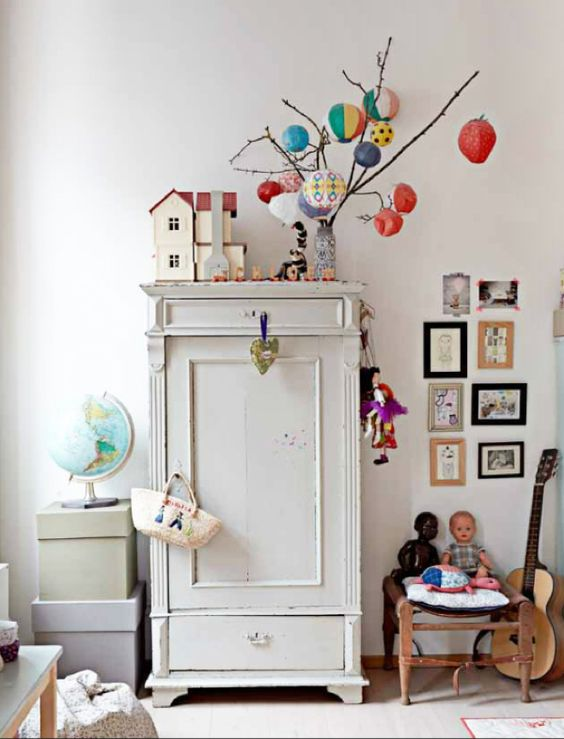 via Rafa-kids: Lille Nord magazine. Kids room with white painted wardrobe, white walls, white floor, picture display, colourful accessories. Love it!
