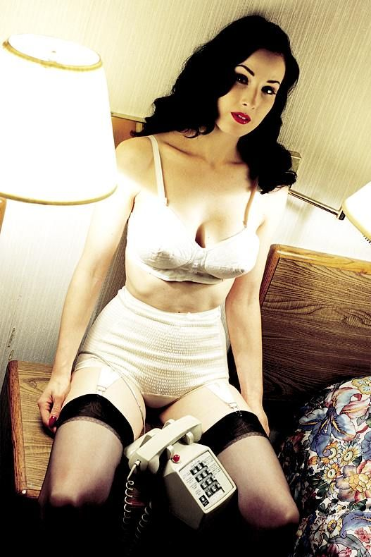 beforethecolon:  Dita waiting for you to call her. Found on an old CD, downloaded from usenet c. 2002.