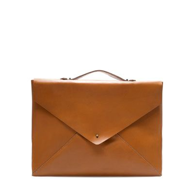 LEATHER BRIEFCASE quirky style, pretty but I don't feel like carrying this