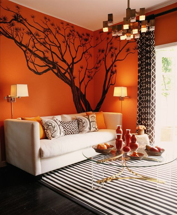 want to do this orange color in our family room, with black and white chevron curtains, white paint trim and a tree decal