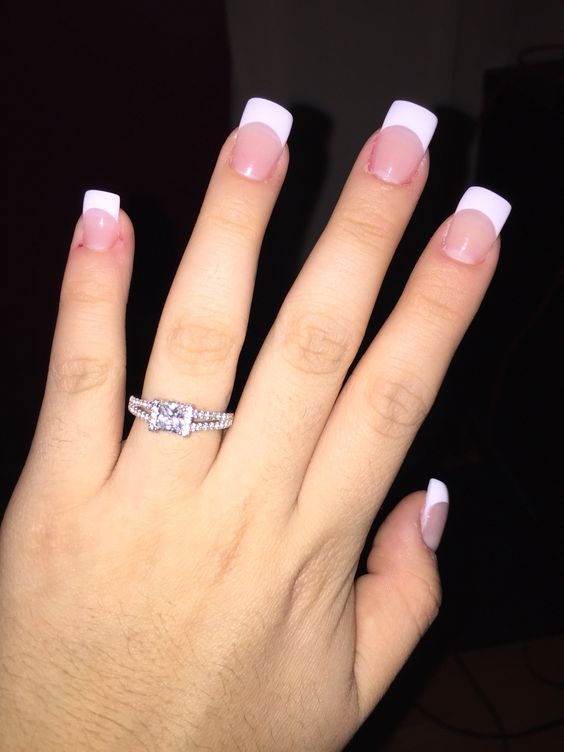 Natural white French acrylic nails.