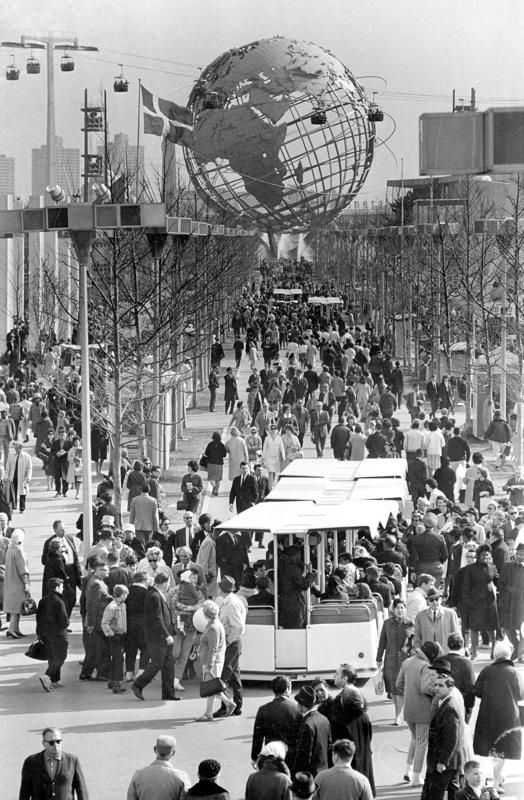 This is a general view of people on the grounds of New York World's Fair and its symbol the Unisphere in background at Flushing Meadows in the Queens borough of New York, Sunday, April 27, 1964. (AP Photo)