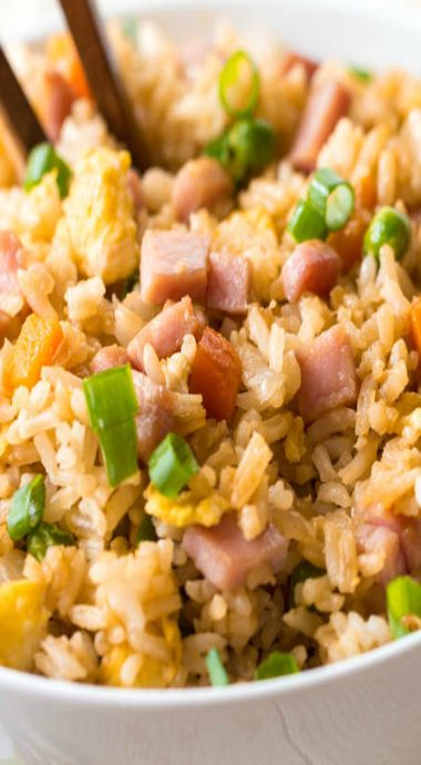 ham fried rice. 1½- 2 c chopped ham, 3 c cooked rice, 2 Tbs sesame oil, 1 small white onion, chopped, 1 c frozen peas & carrots, thawed, 2-3 T soy sauce (more or less to taste), 3 eggs, lightly beaten, 2 T chopped green onions (optional). Preheat a large skillet or wok to medium heat. Pour sesame oil in the bottom. Add white onion, chopped ham, peas and carrots and fry until tender. Slide the onion, peas and carrots to the side, and pour the beaten eggs onto the other side. Using a spatula…