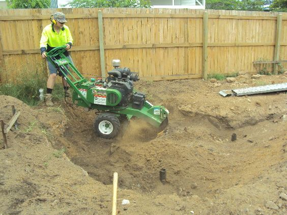 Stump grinders can be the size of a lawn mower or as large as truck. Most accomplish their task by means of a high-speed disk with teeth that grind the stump and roots into small chips. http://bradstreesandlawns.com.au/