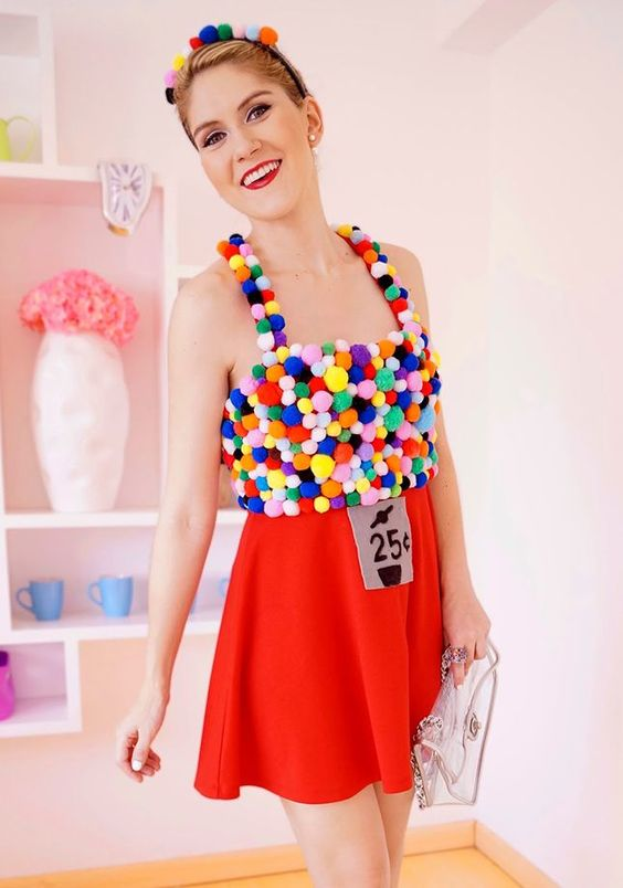 All you need is a red skirt, a big bag of colored pom poms and a shirt to make this bubble gum machine costume.