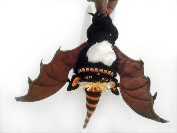 Candy Claws with full wing spread, lots of details, the plushiness has several furry textures, the little feet have pointed toes and there's even a little pointy tail - love the fury textures. This will sell out so get it NOW if you like it.