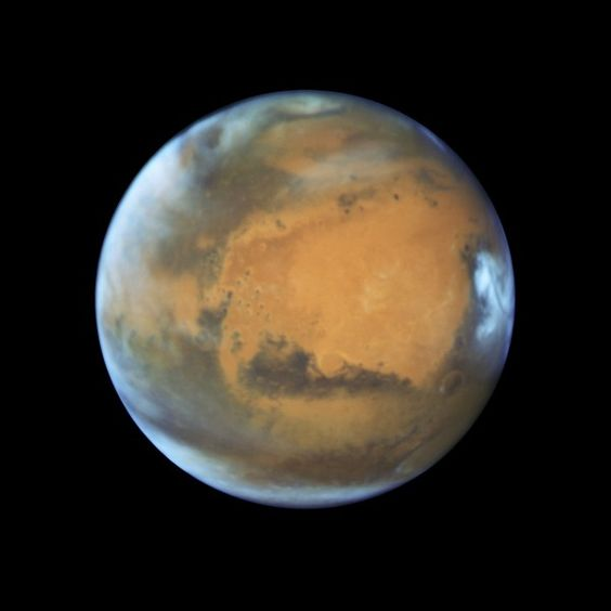 Mars as it was observed shortly before opposition in 2016 by the NASA/ESA Hubble Space Telescope. Image via NASA, ESA, Hubble Heritage Team, J. Bell, M. Wolff.