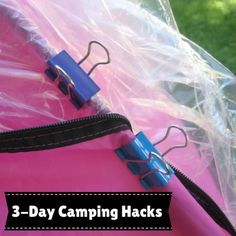 Use binder clips to secure tarp/tent to poles