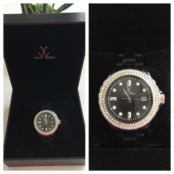 Listing Toy Watch Black plasteramic TOY watch with Swarovski crystal dial. Received this as a gift, and just never get around to wearing it. Included is gift box, extra links, users guide, and original purchase ticket from Nordstrom. In great condition, no scratches on face, few minor wear on band. Just replaced battery. Toy Accessories Watches