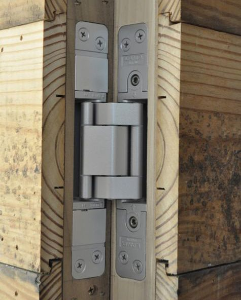 """Article description: """"Everyone loves a house with hidden door or secret rooms, but these are tricky details to pull off successfully.  Here are a few of my recent projects with hidden doors and my favorite hardware to accomplish these works of craftsmanship.""""  Hinges and latches mentioned in the article are available in the UK."""