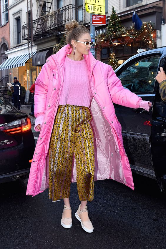 January 9, 2017 - Gigi Hadid In a pink Christina Ledang puffer coat and sweater, Christopher Bu pants, Filling Pieces sneakers, and Illesteva sunglasses while out in NYC.