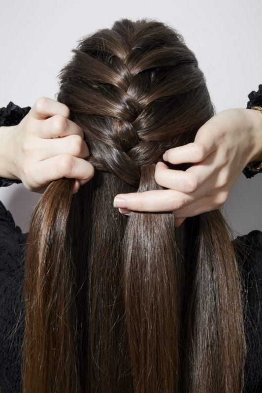 How To French Braid Your Own Hair Brunette Girl Braiding Back Of Head Front Hair Styles Braiding Your Own Hair Goddess Braids Hairstyles