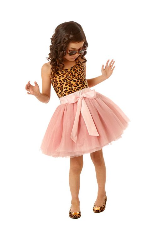 ss15: Ooh! La, La! Couture's three-piece pant set proves that at the gym and school, in the park, sequins are a girl's best friend. Here, the Tie Bow Dress pairs bold animal skin with tulle for a chic party dress. www.oohlalacouture.com (editor's pick)