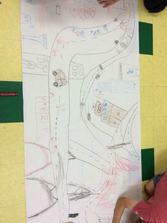 Children make their own town with school, police, the road , hospital ...etc and even Mt.Fuji!