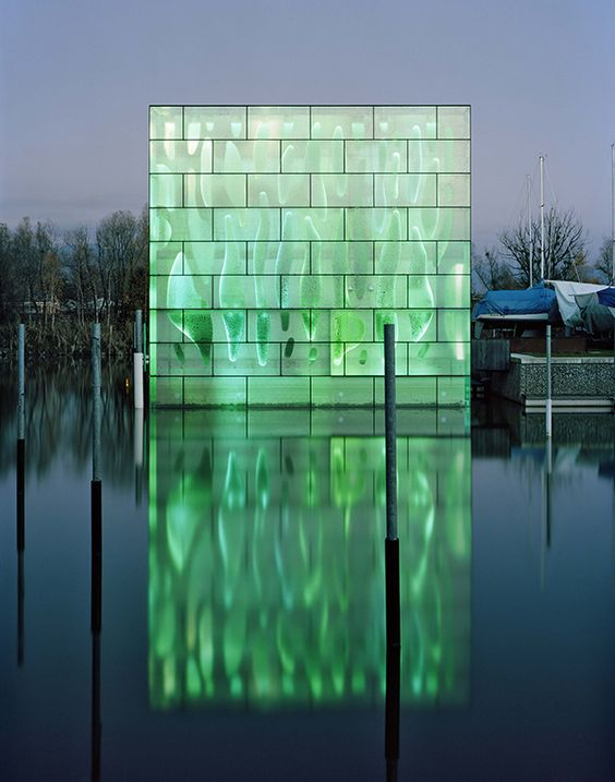 On the sparkling harbor of Lake Constance in #Switzerland, the awesome illuminated Nordwesthaus building sheds some light on modern architecture.