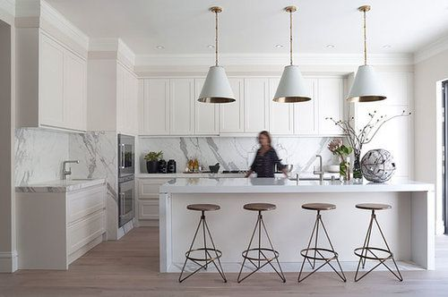 Great marble counters and backsplash with white cabinets.