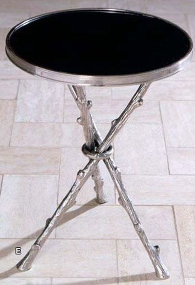 A contemporary twist on a nature-inspired motif with a tripod of nickel twigs bunched together and topped with sleek black granite. | Twig Table cort.com