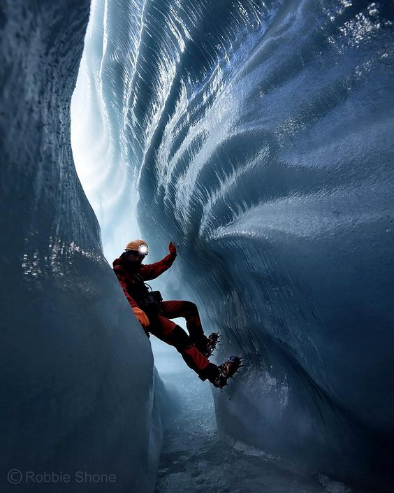 Photo by @shonephoto (Robbie Shone) - About to embark on a journey in the ice an explorer traverses over a pool of water leaving the daylight behind inside a moulin on the Gorner glacier in Switzerland the second largest glacial system in the Alps. by natgeo