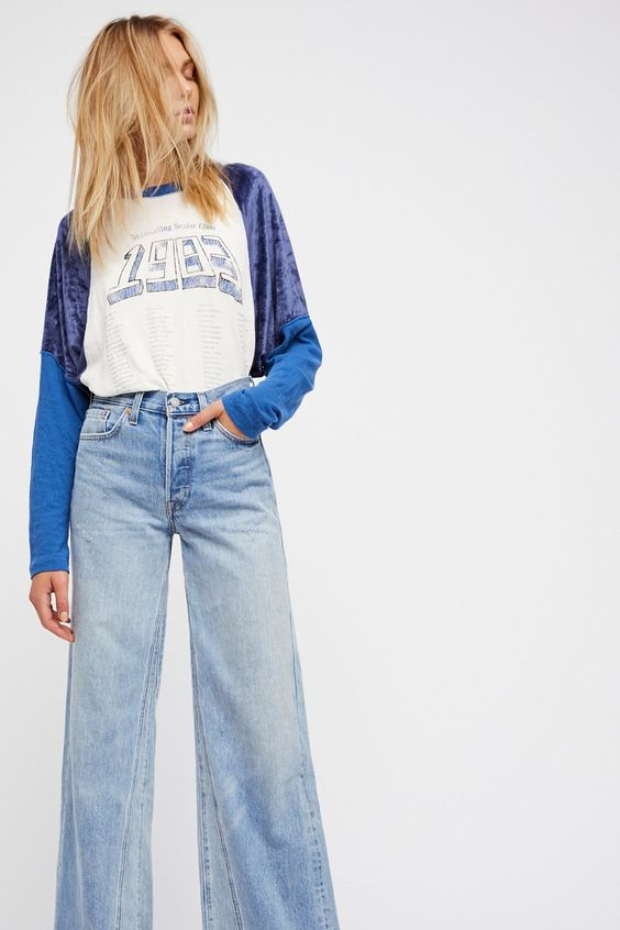 Levi's Altered Wide Leg Jeans | **Fit:** May run small, we recommend sizing up. Levi's has altered one of their most iconic styles to give it a fresh update by adding vertical seams to the back legs and shifting the outer seams forward to make these blast from the past wide legs a must-have pair. * Exaggerated wide legs * Sits at the waist * Relaxed fit through the thigh * Non-stretch, rigid denim * Five-pocket style * Button fly