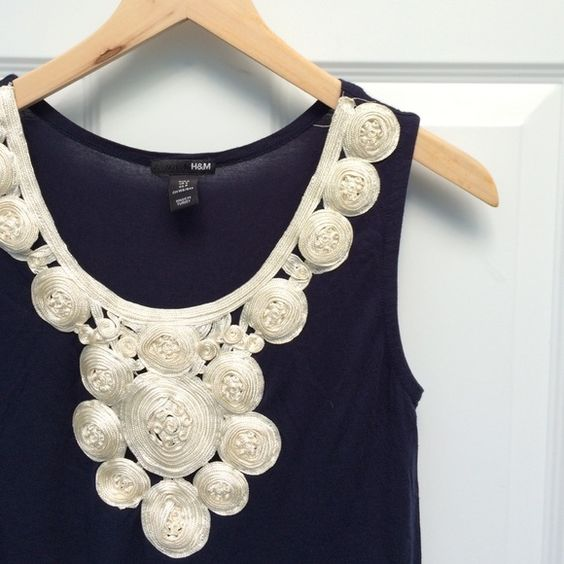 """H&M embroidered s/l tunic *** Price final unless bundled*** Ribbon ivory embroidered neckline on a navy blue tunic by H&M. 100% viscose. Length about 30"""". Cute over leggings. Excellent condition. H&M Tops Tunics"""