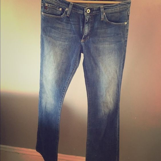 AG Angel boot cut Jeans Size 29R.  Slightly distressed at bottom leg cuff ( see picture ).                                                            No Trades. Offers through offer button only please. AG Adriano Goldschmied Jeans Boot Cut