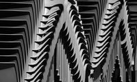 Piled up chairs by Efren Vazquez