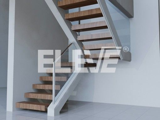 Escalera con pelda os revestidos en madera y barandas de - Barandillas de cristal y madera ...
