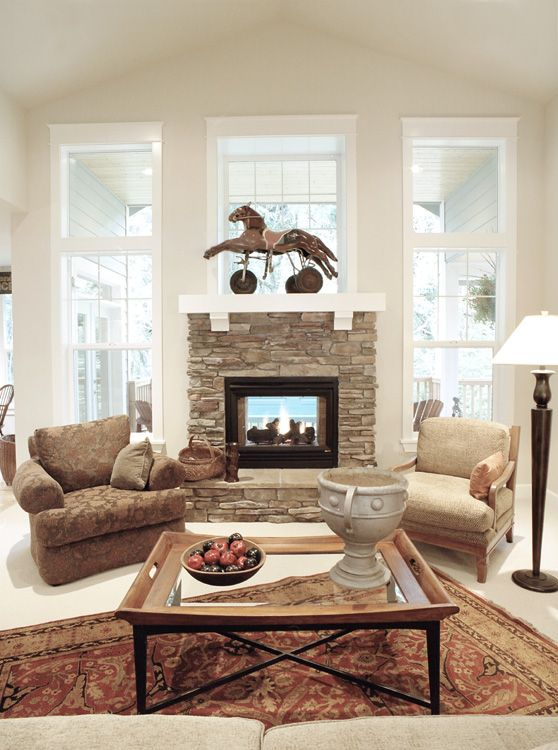 Indoor outdoor fireplace 2002 street of dreams home by o for Inside outside fireplace