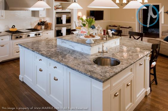 This kitchen has a unique dual level island where the for Aran world kitchen cabinets