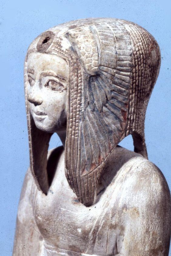 Limestone statue of Tetisheri enthroned; Hieroglyphic text on the block-throne…