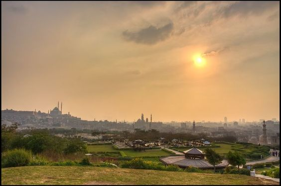 The Sun Hiding Behind The Clouds Over Azhar Park In 2019 Egypt