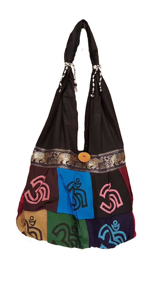 Happy Peace Patchwork Bag Purse Handmade in Nepal Fair Trade By Ragged Ends. Cell phone pocket on strap with velcro closure. Sturdy strap for extra security. heavyweight zipper closure and zippered inner pocket. 100% cotton. made in nepal fair trade.