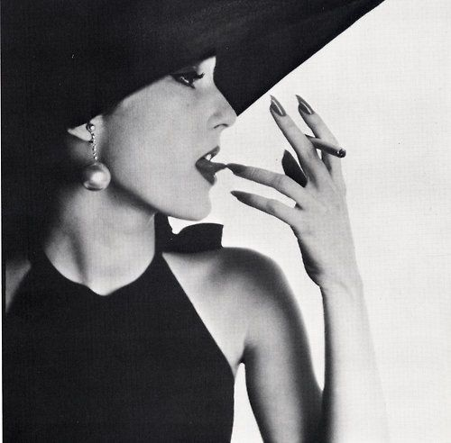 Jeune Fille avec du tabac sur la langue, photo by Irving Penn for Vogue, Apr.1950