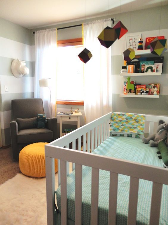 We love this geometric-inspired mobile in this modern, fresh nursery! {Click to see more pictures}