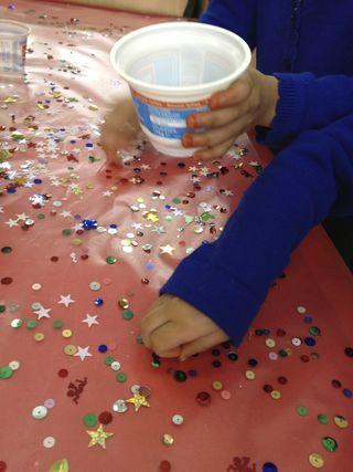 picking little gems off sticky plastic...brilliant for fine motor development #abcdoes #finemotor #eyfs