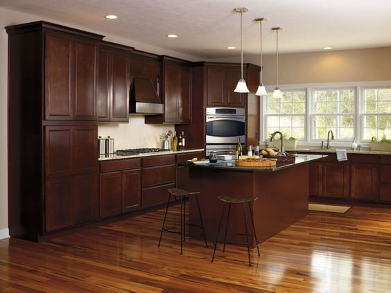 Java Glaze finish on these Maple Landen doors by Aristokraft brings a classic elegance to this kitchen.