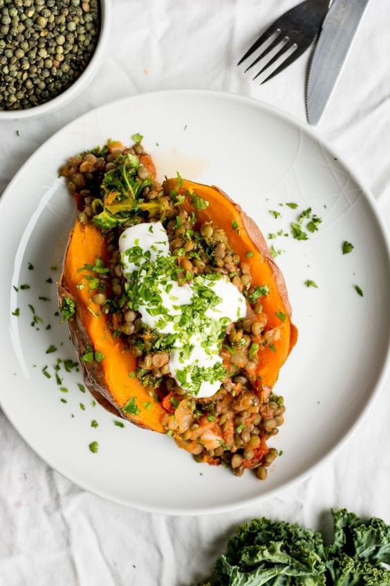 Sweet Potato stuffed with lentils, kale and sun dried tomatoes are a great warming meal when it's freezing cold outside!