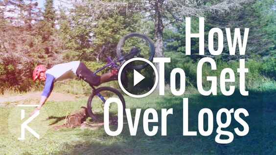 Pedal kicks, bunny hop, and Bump Jumps are all great ways to get over logs on the mountain bike trail.
