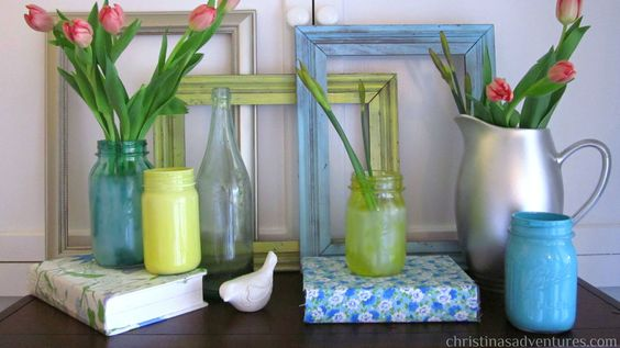Spray a light coat of paint over some thrifted frames and let them stand as the backdrop for a sprightly mantle. Allow the wood to shine through to give the frame a vintage feel. Cover books with scraps of floral fabric and add in a few painted mason jars. Decorate with fresh flowers, such as tulips or peonies, and your display is complete. Get the tutorial.  - GoodHousekeeping.com