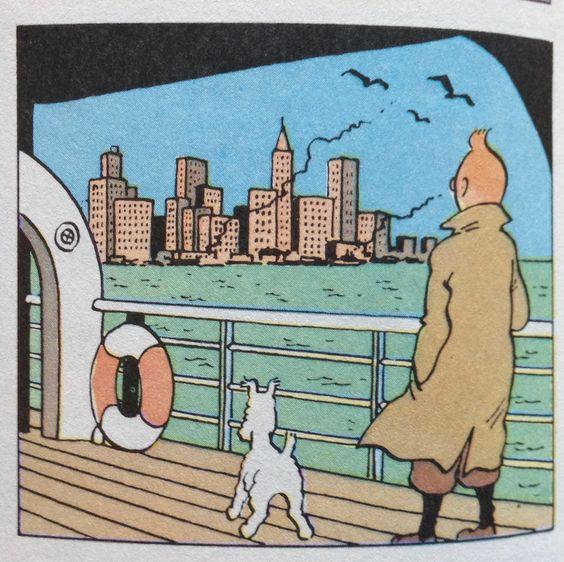 船上に佇むスノーウィとタンタンの画像