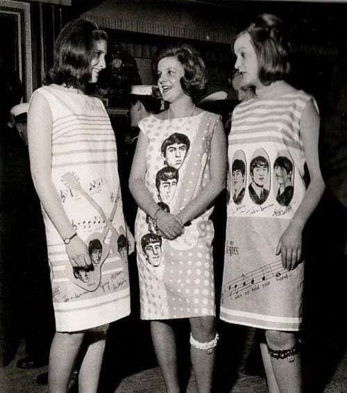 Beatlemania  Girls wearing The Beatles paper dresses, 1960s.: