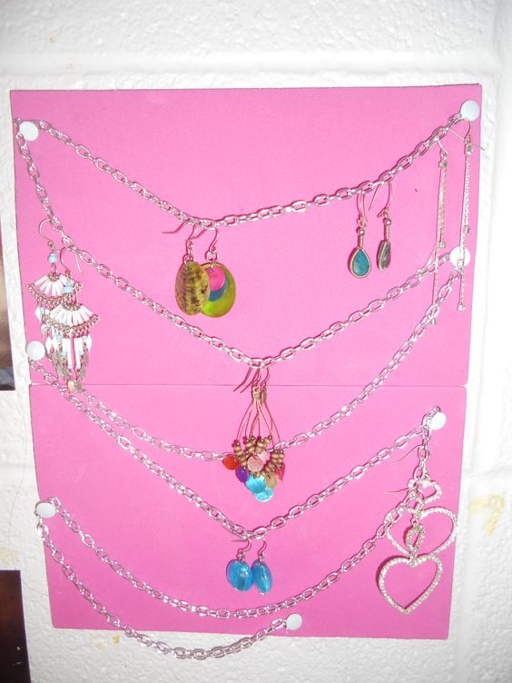 some foam, glue, a chain, and a college dorm. EARRING HOLDER! (: